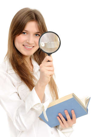 Businesswoman using magnifying glass on a white background