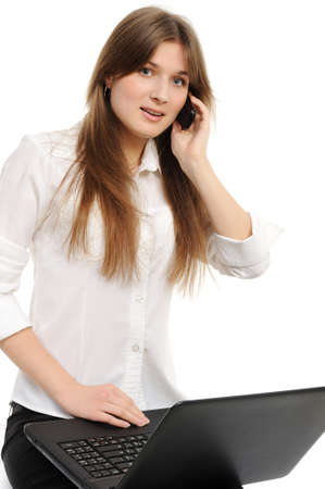 Portrait of beautiful business woman with laptop speaks via phone photo