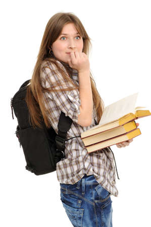 girl with a backpack and books, is surprised; on a white background Stock Photo - 9111756