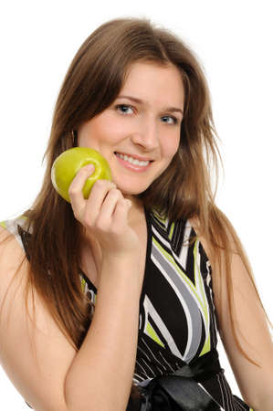Portrait of cheerful young woman holding a  green apple and smiling isolated against white background  Stock Photo - 9306165
