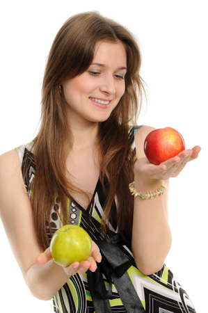 Young woman holding two apples - green and red.