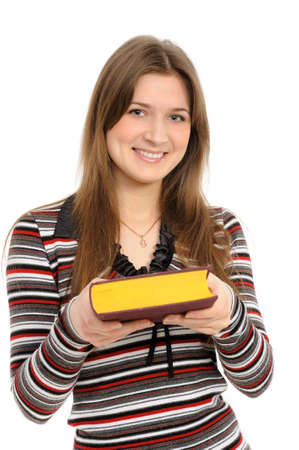 young girl submits the book on white background  Stock Photo