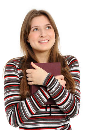 student girl with books, thinks, on white background photo
