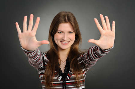 Portrait of pretty woman pointing at you with both hands