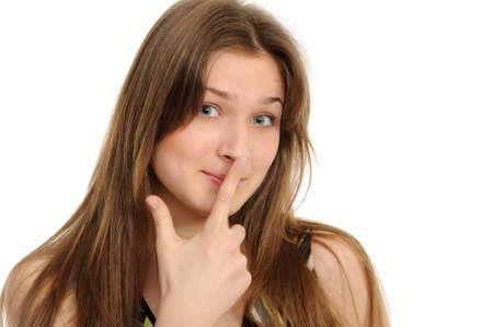 nariz: Retrato de una joven feliz haciendo gestos sobre fondo blanco  Foto de archivo