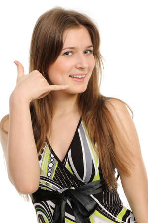 Picture of lovely woman making a call me gesture On a white background photo