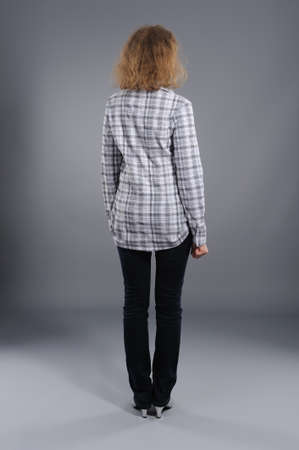 young woman rear view  against grey background Stock Photo - 9594611