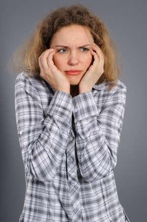 upset woman isolated  on grey background  photo