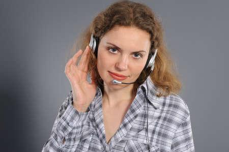 female customer service representative in headset,  on a grey background photo
