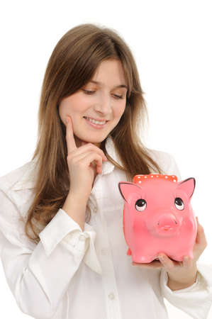 woman with a piggybank isolated on white  background photo