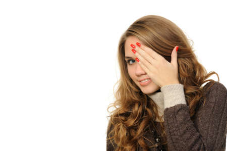 Young female is gazing through her fingers  Stock Photo