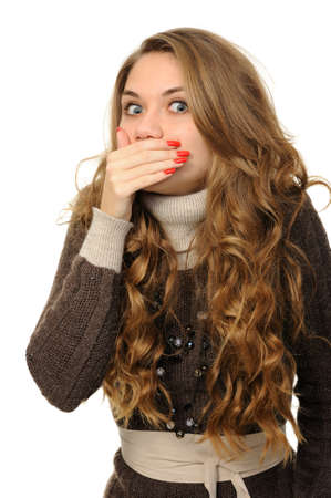 hearsay: Young woman says ssshhh to maintain silence on a white background