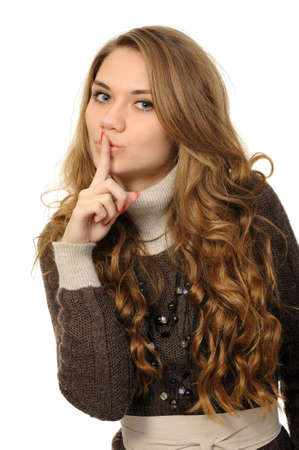 Young woman says ssshhh to maintain silence on a white background photo