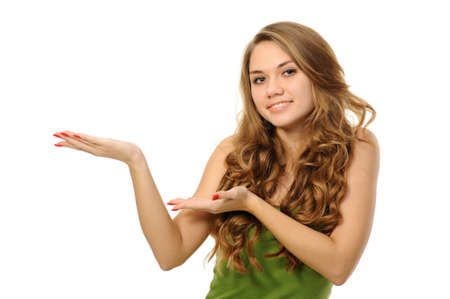 woman pointing: woman presenting something imaginary over white
