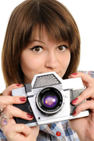 Pretty woman  with vintage camera photo