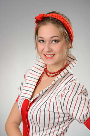 portrait of happy young woman with a red bandage on a head