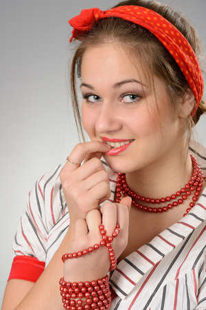 Portrait the young woman with a red bandage on a head