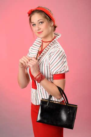 Retro lady with purse Stock Photo