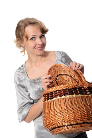 Portrait of a attractive woman holding a basket and smiling