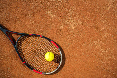 Tennis racket and ball on the court