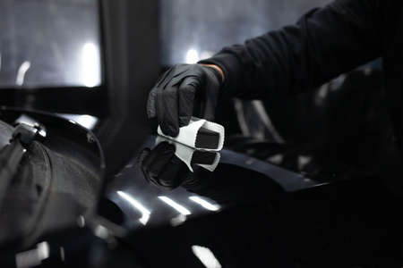 Applying nanoceramics to cars. Car paint protection concept Imagens