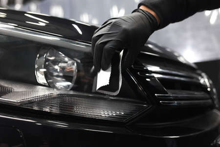 Applying of protective nanoceramics on car headlights Archivio Fotografico