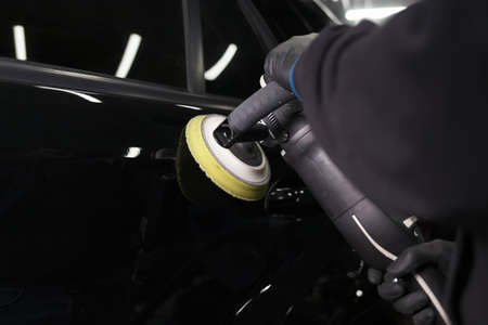 Car body polishing process at the detailing workshop