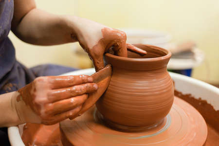 Potter gives final shape to clay product