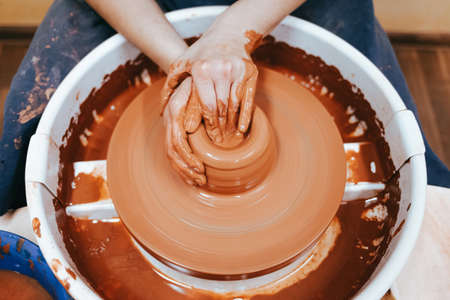 Potter forms clay products into future ceramic dishes. Process of creating clay products close-up