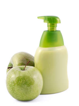 Green apple liquid soap isolated on white
