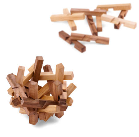 conundrum: Wooden puzzle isolated on white Stock Photo