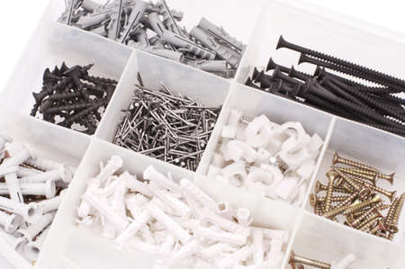 Screws, nails, dowels in the case photo