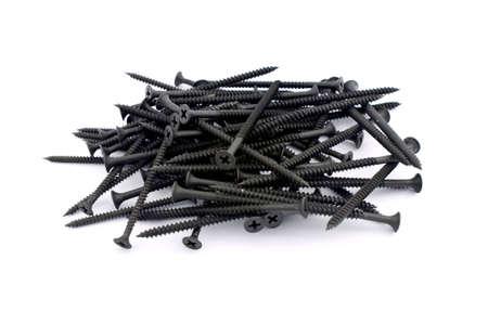 Black screws isolated on white photo