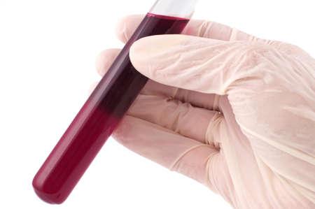 red tube: Azienda mano rosso tubo isolato su bianco  Archivio Fotografico