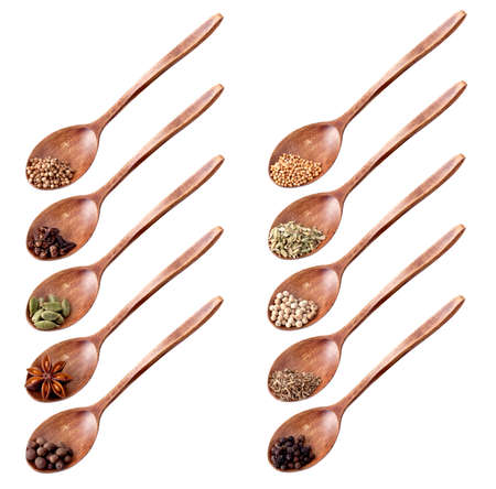 Wooden spoon full of different spices isolated on white background photo