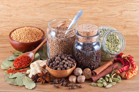 Still life of different spices on wooden background photo