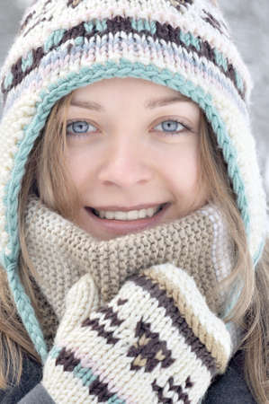 Portreit of young smiling winter woman photo