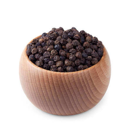 Wooden bowl full of black pepper isolated on white background Stock Photo