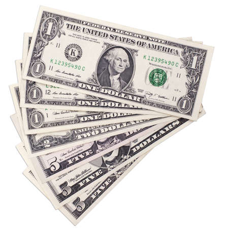 small dollar bills isolated on white background photo