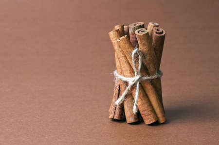 Cinnamon stick on brown background