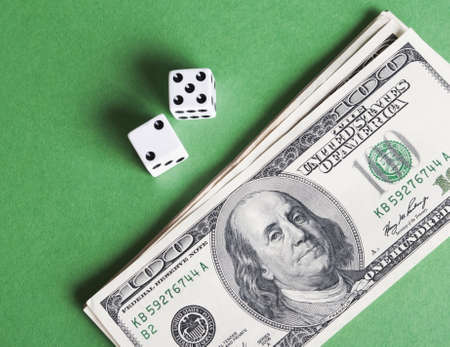 white dices and dollars on green background photo
