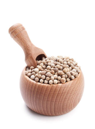 Wooden scoop in bowl full of white peppercorn isolated on white background Stock Photo
