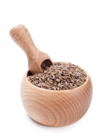 Wooden scoop in bowl full of dill seeds isolated on white background Stock Photo - 12783312