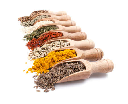 Row of wooden shovels with spices in them. Diminishing perspective Stock Photo - 12783251