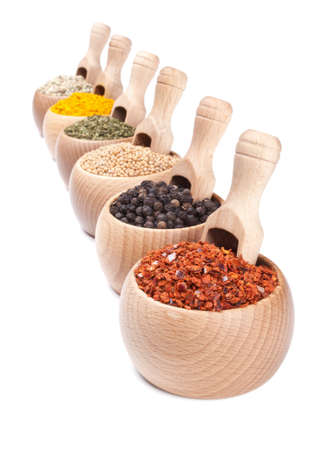 diminishing: Row of wooden bowls with spices in them. Diminishing perspective