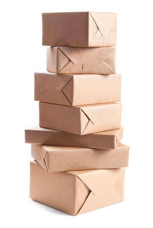wrapped present: Stack of parcel wrapped with brown packing paper isolated on white Stock Photo
