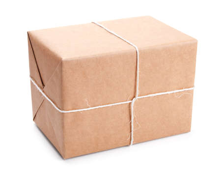 Parcel wrapped with brown packing paper tied with twine isolated on white Stock Photo - 13126986