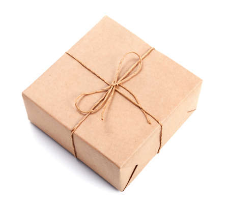 twine: Parcel wrapped with brown packing paper tied with twine isolated on white Stock Photo