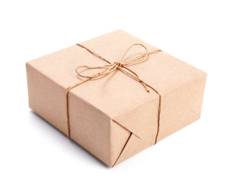 Parcel wrapped with brown packing paper tied with twine isolated on white Stock Photo