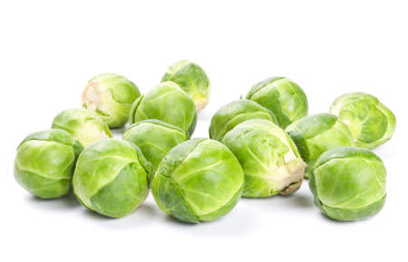 Fresh green Brussels sprouts isolated on white background Stock Photo